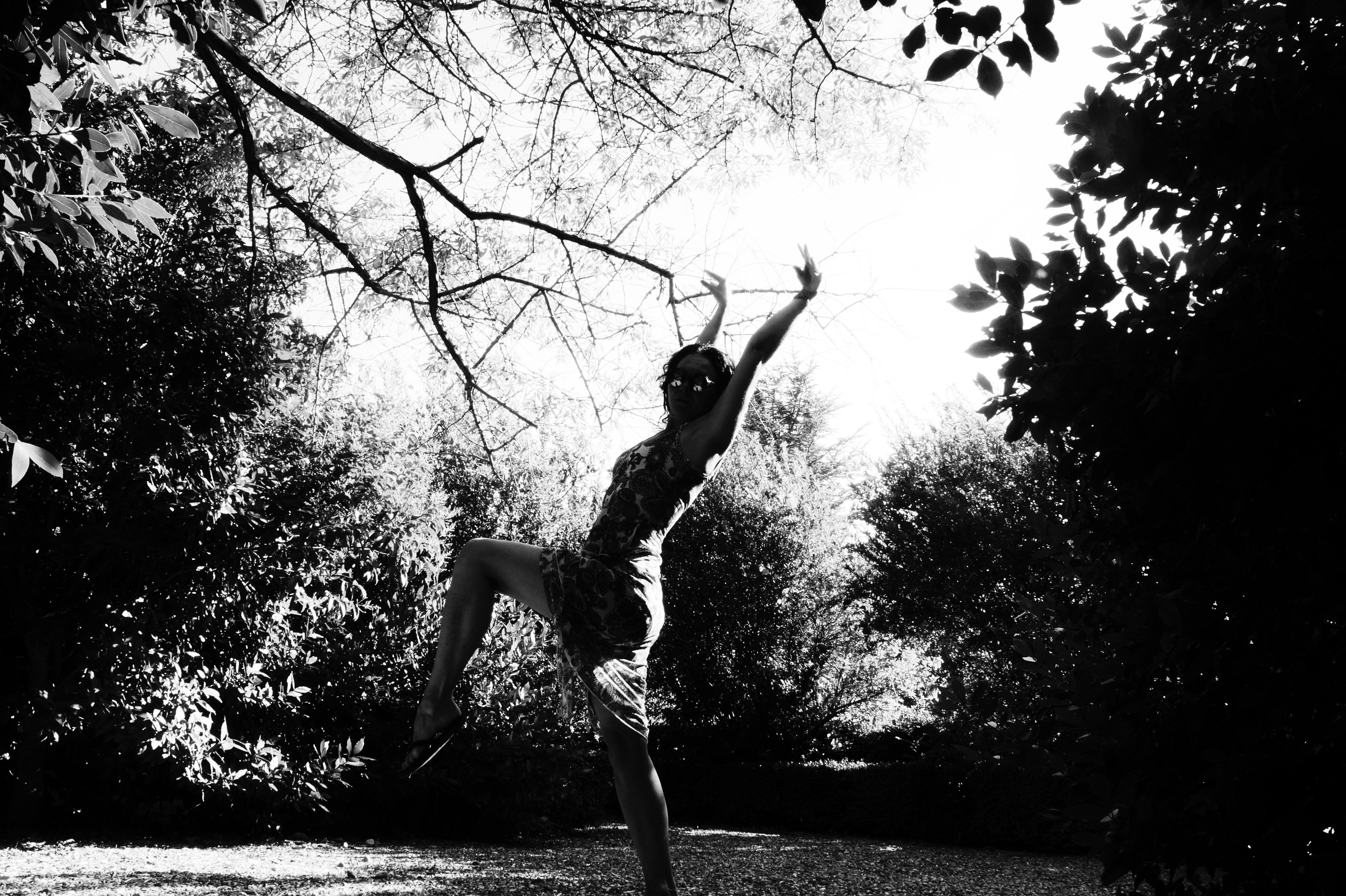 Woman dancing in a garden